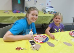 Campbell E. and Teghan R. have Summer Reading Fun in the Craft Room.
