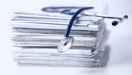 Medical stethoscope on the stack of paper