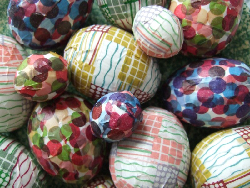 assorted sizes of washi tape covered eggs