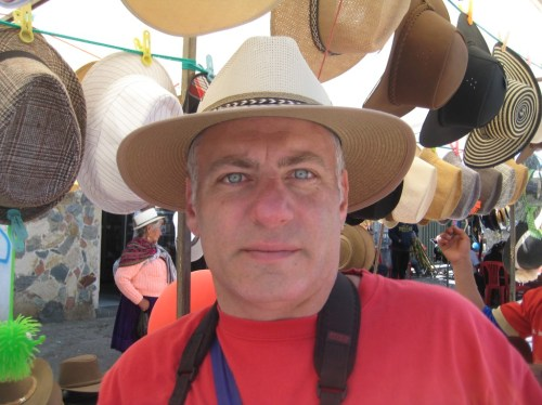 Tony tries on a traditional Panama hat at a street market.