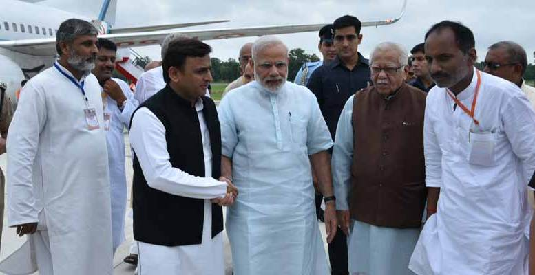 PM Modi received by UP governor Ram Naik and CM Akhilesh Yadav in Gorakhpur upon his arrival in the state.