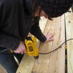 Me, drilling holes in the posts for carriage bolts.
