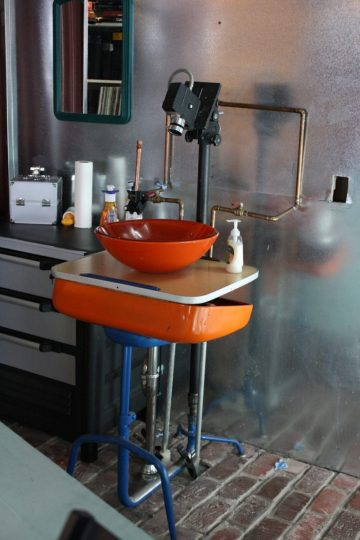 A DIY'ed sink, made out of a school desk and 8mm camera.