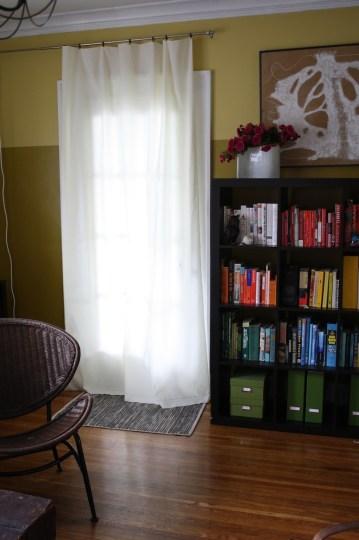 Shortened curtain, happy sunroom door.