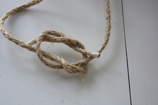 Making a square knot.