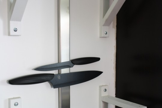 Testing out the new black knives on our kitchen wall. See how we have some wall touch-ups to do?