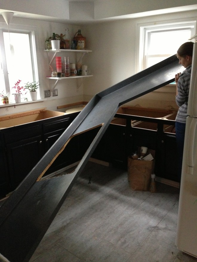That's a big piece of laminate countertop. And right about here, we almost got it out of the kitchen in one piece.