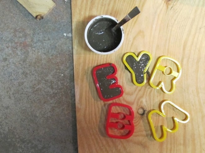 Crafty portland cement letters using cookie cutters.
