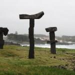 Basalt rock statues along the ocean.