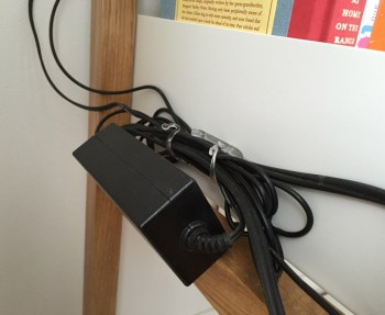 Organize cords with open shelving.
