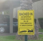 BACKED IN and improperly parked vehicles will be towed immediately at owner's expense