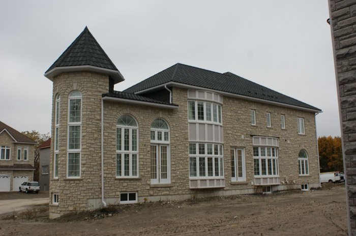 This Beautiful Fieldstone Home In Ontario Features A Durable Steel Roof  From Metal Roof Outlet