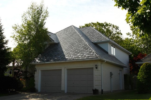 This Ontario home has a beautiful slate-style steel roof from Metal Roof Outlet which catches the late afternoon sun.