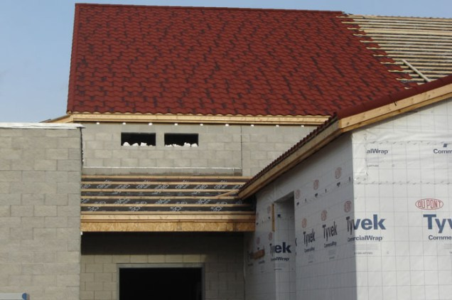 Take a closer look at the construction process - from top to bottom, this home is built to last with concrete walls and an extremely durable and gorgeous steel continental tile roof by Metal Roof Outlet, Ontario.