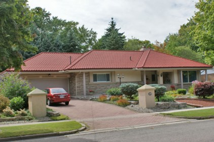 Brighten up a beige home with a red steel tile roof from Metal Roof Outlet, Ontario.