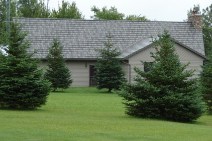 We love the monochromatic look of a slightly varied dove grey shake roof paired with dove grey siding.