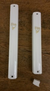 Waterproof white mezuzah cases $6. These cases are one peice with a plug on the bottom.