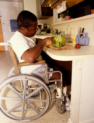 Knee space under cabinets accommodate wheelchairs