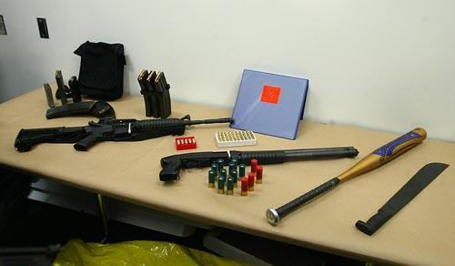 Aaron Kyle Huff's weaponry (photo (c)2006 Greg Gilbert/The Seattle Times)