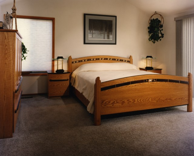 Red oak bedroom set with dressers bed and nightstands.