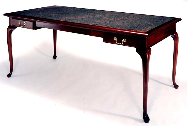 Mahogany desk with stone top.