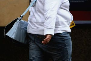 An-overweight-person-walks-through-Glasgow-city-centre