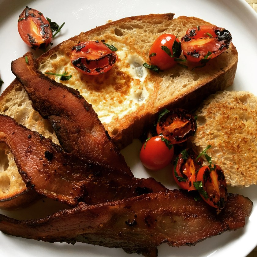 Toad in the Hole with Crispy Bacon and Blistered Cherry Tomatoes
