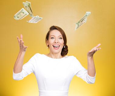 Make it rain. Portrait happy woman throwing money in air