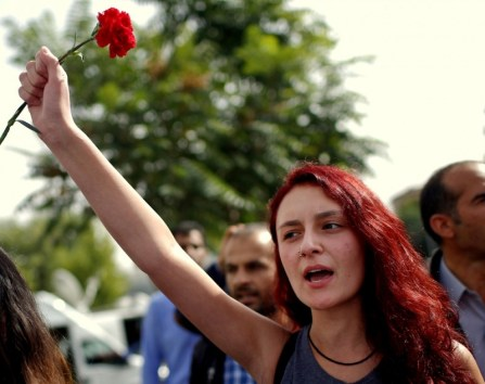 A woman participates at a memorial service for the victims of Saturday's attacks , at the site of the bombings in Ankara, Turkey, Monday, Oct. 12, 2015. The twin explosions Saturday ripped through a crowd of activists rallying for increased democracy and an end to violence between Kurdish rebels and Turkish security forces, killing dozens and injuring scores of others, in Turkey's deadliest attack in years. (AP Photo/Emrah Gurel)