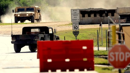 Military vehicles are seen at Texas Army National Guard Camp Swift, Wednesday, July 15, 2015, in Bastrop, Texas. Jade Helm 15, a summer military training exercise, that has aroused alarm among some Texans, begins Wednesday outside the Central Texas town of Bastrop.