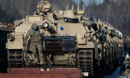 Abrams battle tanks from the US Army's 4th Infantry Division on rail cars as they arrive at the Gaiziunai railway station in Lithuania, Feb. 10, 2017.(AP/Mindaugas Kulbis)