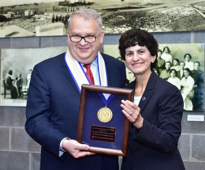 """Mary A. Papazian, President of Southern Connecticut State University, at right, awards the SCSU President's Medal of Honor to Rouben Mirzakhanyan, Thursday, September 10, 2015, at a reception at the John Lyman Performing Arts Center Lobby Gallery at SCSU. Mirzakhanyan is rector at Armenian State Pedagogical University After Khachatur Abovyan in Yerevan, Armenia. The presentation was held during the opening for an photography exhibit, """"Bearing Witness to the Lost History of An Armenian Family:Through the Lens of the Dildilian Brothers presented by Armen T. Marsoobian, professor and chair of philosphy at SCSU and editor of the journal Metaphilosophy. (Catherine Avalone/New Haven Register)"""