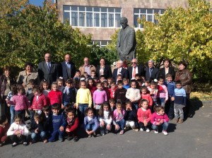 TCA members from US, Canada, England and Greece in front of the bust of Vahan Tekeyan with students of Garpi School