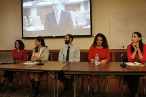 From left, moderator Dr. Anna Ohanyan with panelists Armine Mosiyan, Constantine Grigoryan, Anna Astvatsaturian Turcotte and Olya Yordanyan, with Northeastern University President Joseph Aoun on the screen above them.