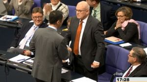 Green Party leader Cem Özdemir (left) seals the promise with a handshake with CDU Parliamentary Faction Leader Volker Kauder