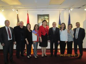 Diaspora Minister Hranoush Hakobyan at center of table with UN Amb. Zohrab Mnatsakanyan standing behind her, surrounded by leaders of Armenian-American organizations at the UN Mission