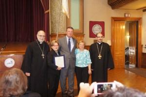From left, Fr. Antranig Baljian, Houry Boyamian holding the proclamation of the Peabody mayor's office, Rep. Tom Walsh, Jackie Torigian, and Fr. Stephan Baljian