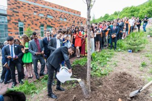 Armenian students planting the last of the 48 trees, symbolizing the number of nationalities represented by the UWC Dilijan graduating class of 2016.