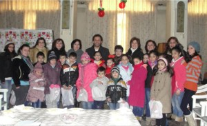 Staff and orphans helped by the Armenian Missionary Association of America in Syria