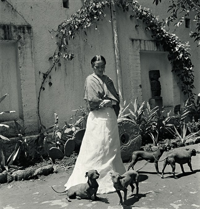 Frida Kahlo with her dogs in Coyoacán, Mexico City, 1951.