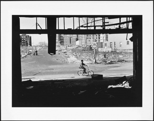 Life carries on in the War Zone. 1975-1981. Gelatin silver print. Museum of the City of New York, Gift of Roberta Perrymapp, 2013.12.1 Read more at http://www.craveonline.com/art/1002663-bearing-witness-south-bronx-america#AvPVsD6DLweheVSj.99. © Mel Rosenthal.