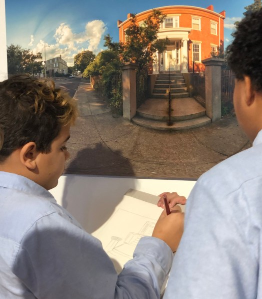 Students sketch architecture from the Black Spaces Matter exhibit in New Bedford, MA.