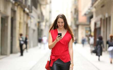mobile shopping lady in red