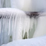 frozen pipes with icicles hanging off them