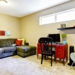 Basement living room with high window