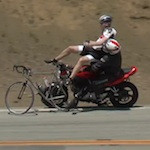 Video: Motorcycle Creams Two Bicyclists