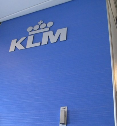 KLM Business Class with logo on bulkhead wall.
