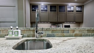 Sink with cabinets in background.