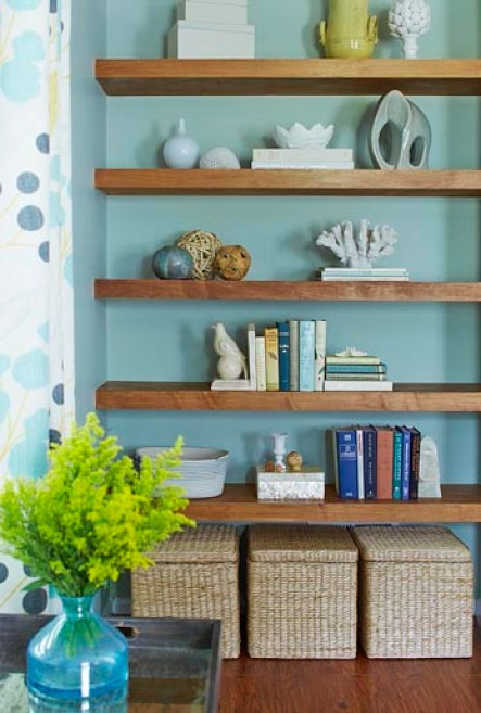 Shelving against turquoise wall.