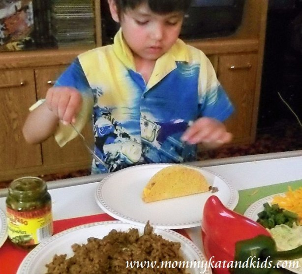 boy making old el paso tacos